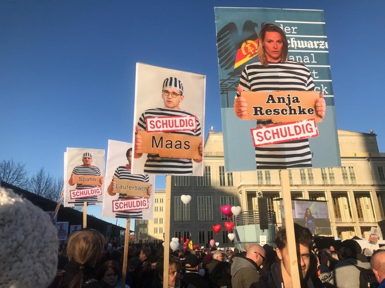 posters on COVID 19 Corona protest in Leipzig against journalists and politicians
