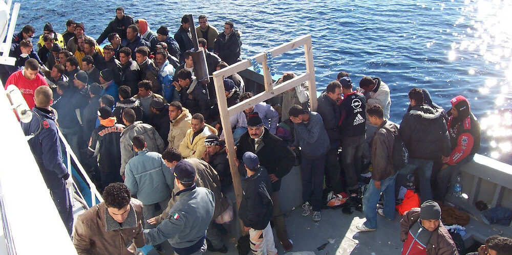 Migrants on a boat in Sicily